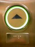 上ボタンと点字表記