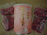 さくら茶の缶と中身。桜のつぼみの塩漬けですね